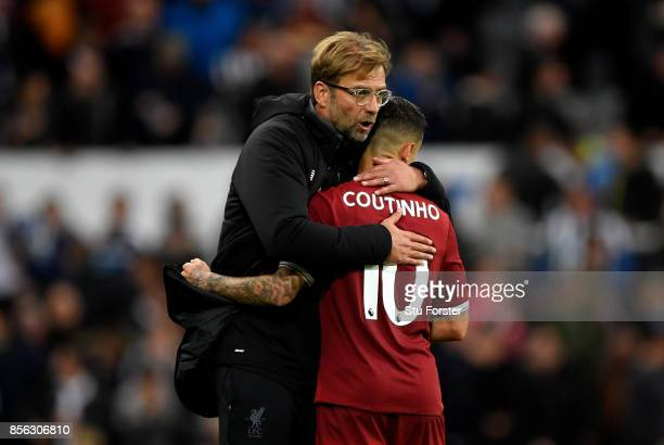 Jurgen Klopp Manager of Liverpool and Philippe Coutinho of Liverpool embrace after the Premier League match between Newcastle United and Liverpool at...