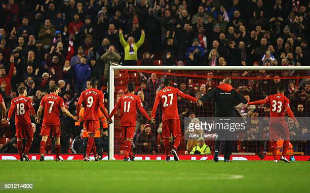 Jurgen Klopp manager of Liverpool and player salute The Kop after the Barclays Premier League match between Liverpool and West Bromwich Albion at...