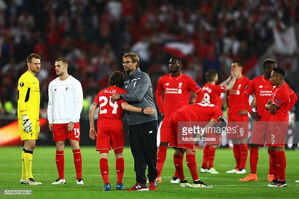 Jurgen Klopp manager of Liverpool and players look on at the award ceremoy after the UEFA Europa League Final match between Liverpool and Sevilla at...