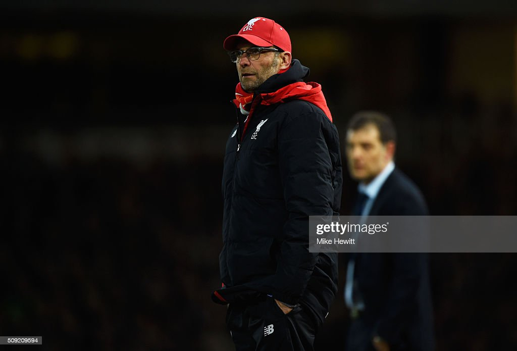 Jurgen Klopp manager of Liverpool (L) and <a gi-track='captionPersonalityLinkClicked' href=/galleries/search?phrase=Slaven+Bilic&family=editorial&specificpeople=1040506 ng-click='$event.stopPropagation()'>Slaven Bilic</a> manager of West Ham United look on during the Emirates FA Cup Fourth Round Replay match between West Ham United and Liverpool at Boleyn Ground on February 9, 2016 in London, England.