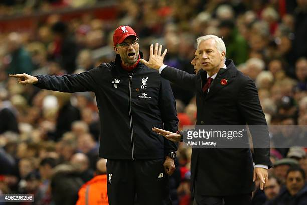 Jurgen Klopp Manager of Liverpool argues with Alan Pardew Manager of Crystal Palace during the Barclays Premier League match between Liverpool and...