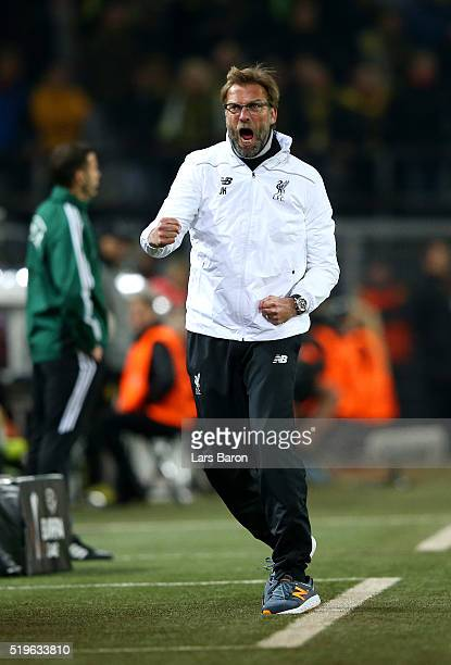 Jurgen Klopp manager of Liverpool celebrates as Divock Origi of Liverpool scores their first goal during the UEFA Europa League quarter final first...