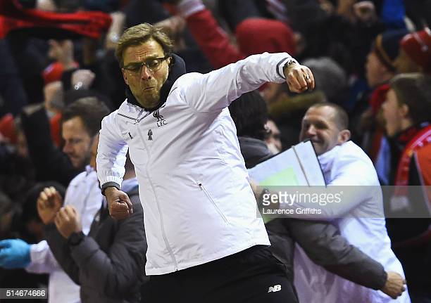 Jurgen Klopp manager of Liverpool celebrates as Roberto Firmino of Liverpool scores their second goal during the UEFA Europa League Round of 16 first...
