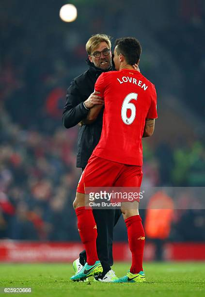 Jurgen Klopp Manager of Liverpool celebrates Dejan Lovren after their 20 win in the Premier League match between Liverpool and Sunderland at Anfield...