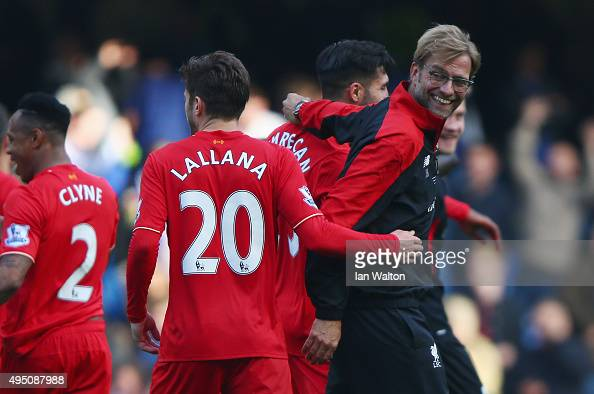 Jurgen Klopp manager of Liverpool celebrates his team's 31 win with his players after the Barclays Premier League match between Chelsea and Liverpool...