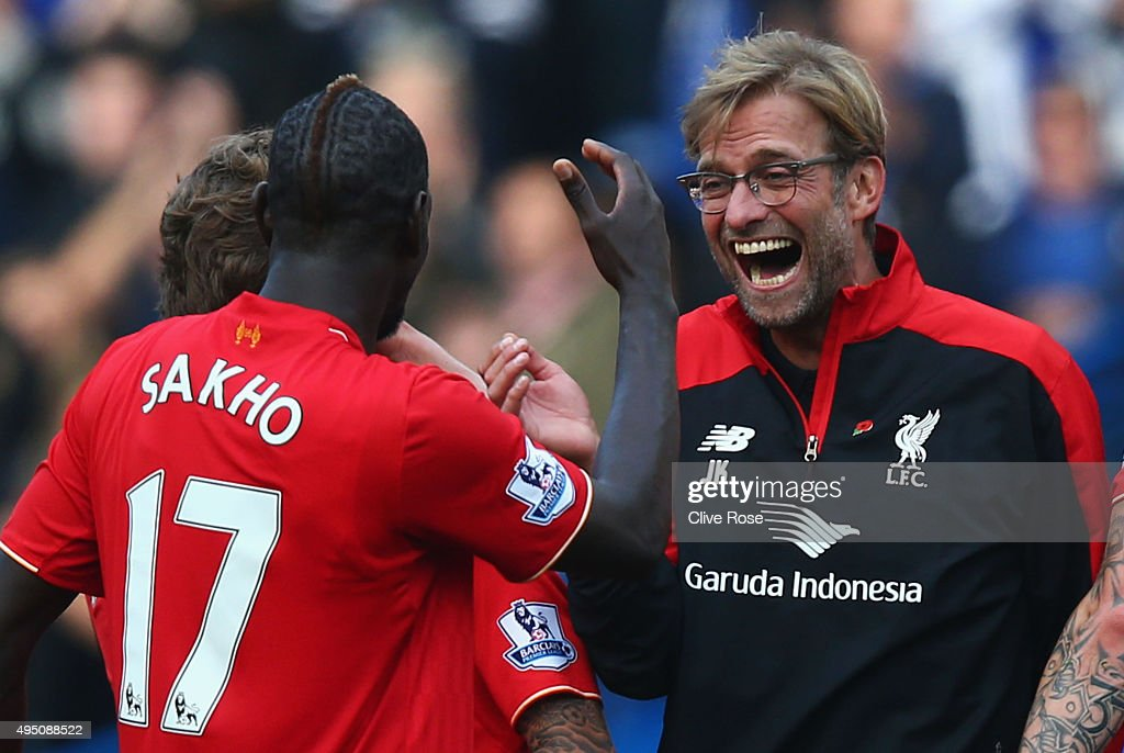 Jurgen Klopp (R), manager of Liverpool celebrates his team's 3-1 win with his player Mamadou Sakho (L) after the Barclays Premier League match between Chelsea and Liverpool at Stamford Bridge on October 31, 2015 in London, England.