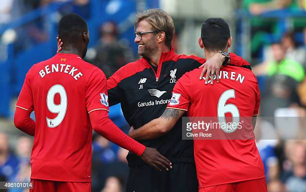 Jurgen Klopp manager of Liverpool celebrates his team's 31 win with his players Christian Benteke and Dejan Lovren after the Barclays Premier League...