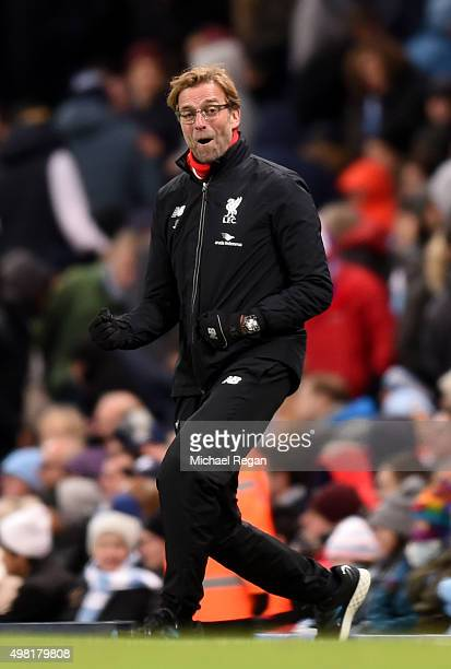 Jurgen Klopp manager of Liverpool celebrates his team's fourth goal during the Barclays Premier League match between Manchester City and Liverpool at...