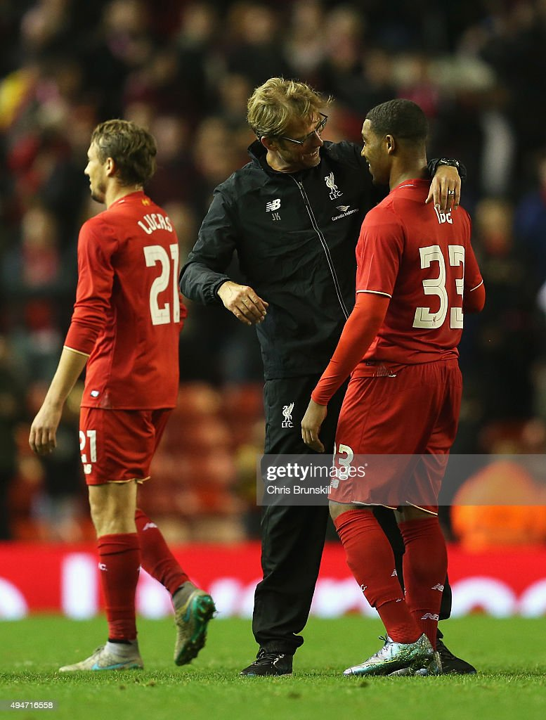 Jurgen Klopp, manager of Liverpool celebrates victory with Jordon Ibe of Liverpool after the Capital One Cup Fourth Round match between Liverpool and AFC Bournemouth at Anfield on October 28, 2015 in Liverpool, England.