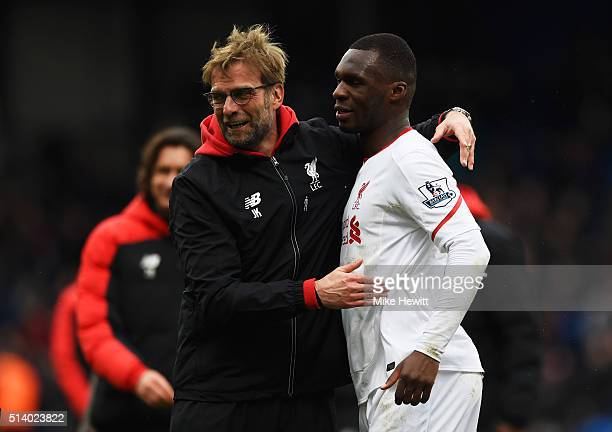 Jurgen Klopp manager of Liverpool celebrates victory with winning goalscorer Christian Benteke of Liverpool after the Barclays Premier League match...
