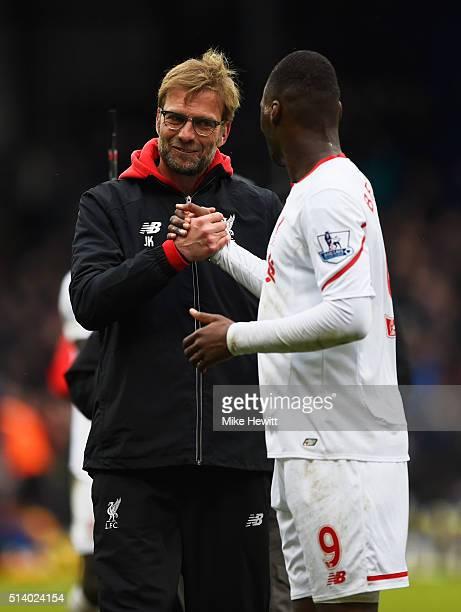 Jurgen Klopp manager of Liverpool celebrates victory with winning goalscorer Christian Benteke of Liverpool after the Barclays Premier League match...