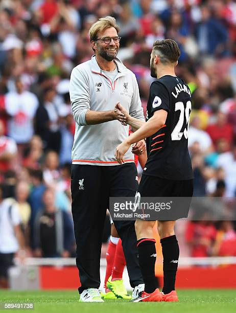 Jurgen Klopp Manager of Liverpool celebrates with Adam Lallana of Liverpool after the Premier League match between Arsenal and Liverpool at Emirates...