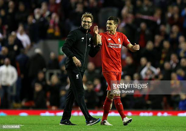 Jurgen Klopp Manager of Liverpool celebrates with Dejan Lovren of Liverpool following the Barclays Premier League match between Liverpool and...