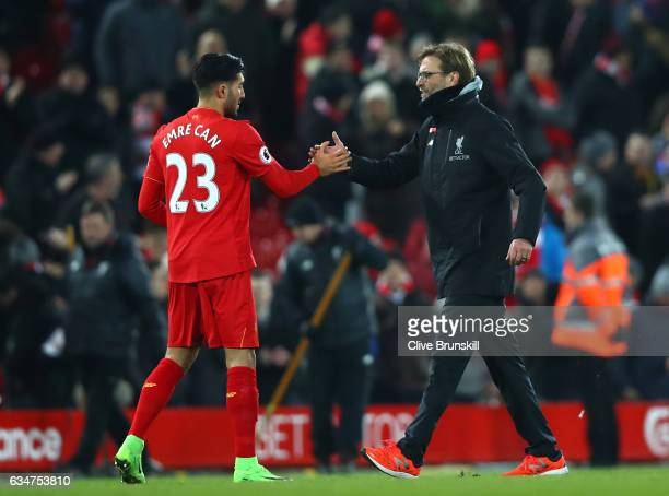 Jurgen Klopp Manager of Liverpool celebrates with Emre Can after the Premier League match between Liverpool and Tottenham Hotspur at Anfield on...