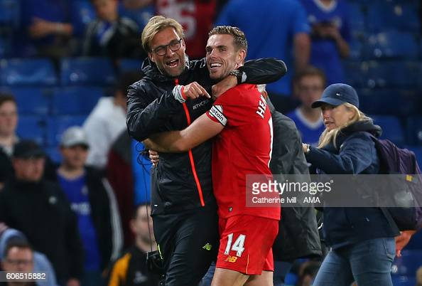 Jurgen Klopp manager of Liverpool celebrates with Jordan Henderson of Liverpool after the Premier League match between Chelsea and Liverpool at...