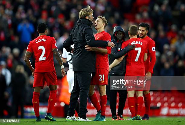 Jurgen Klopp Manager of Liverpool celebrates with Lucas Leiva of Liverpool during the Premier League match between Liverpool and Watford at Anfield...