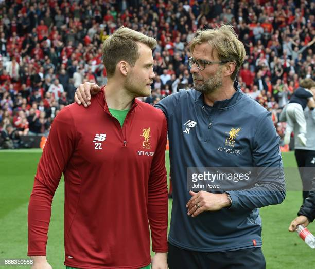 Jurgen Klopp manager of Liverpool celebrates with Simon Mignolet of Liverpool at the end of the Premier League match between Liverpool FC and...