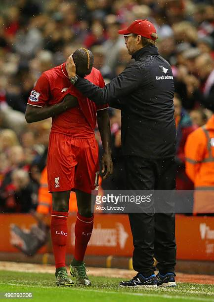 Jurgen Klopp Manager of Liverpool consoles Mamadou Sakho of Liverpool who leaves the field injured during the Barclays Premier League match between...
