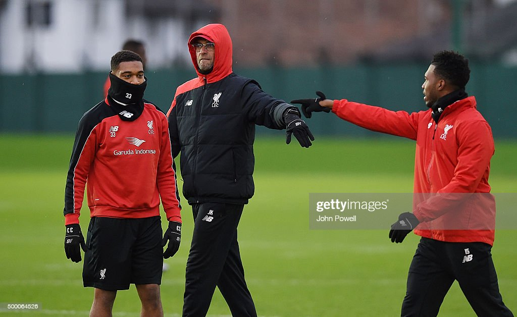 Jurgen Klopp manager of Liverpool Daniel Sturridge and Jordon Ibe during a training session at Melwood Training Ground on December 5, 2015 in Liverpool, England.