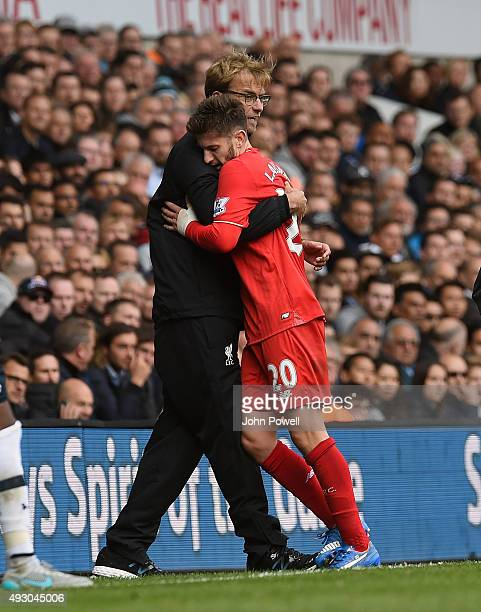 Jurgen Klopp manager of Liverpool embraces Adam Lallana of Liverpool during the Barclays Premier League match between Tottenham Hotspur and Liverpool...
