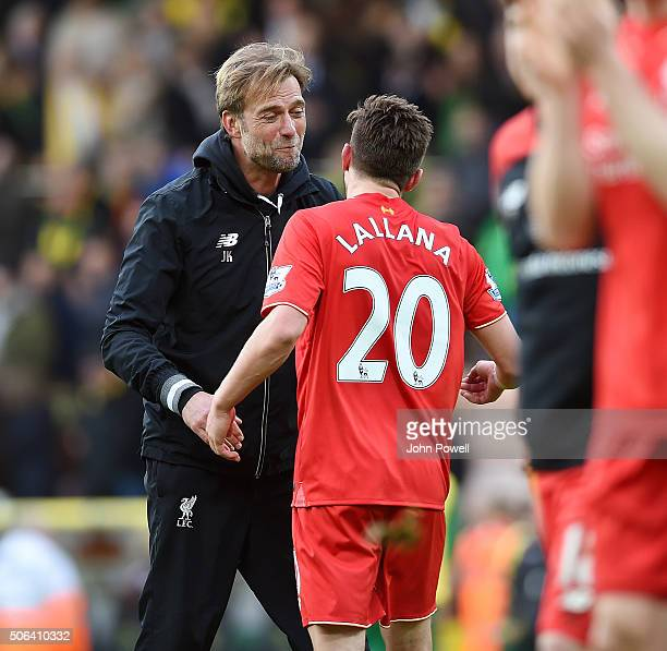 Jurgen Klopp manager of Liverpool embraces Adam Lallana of Liverpool at the end of the Barclays Premier League match between Norwich City and...