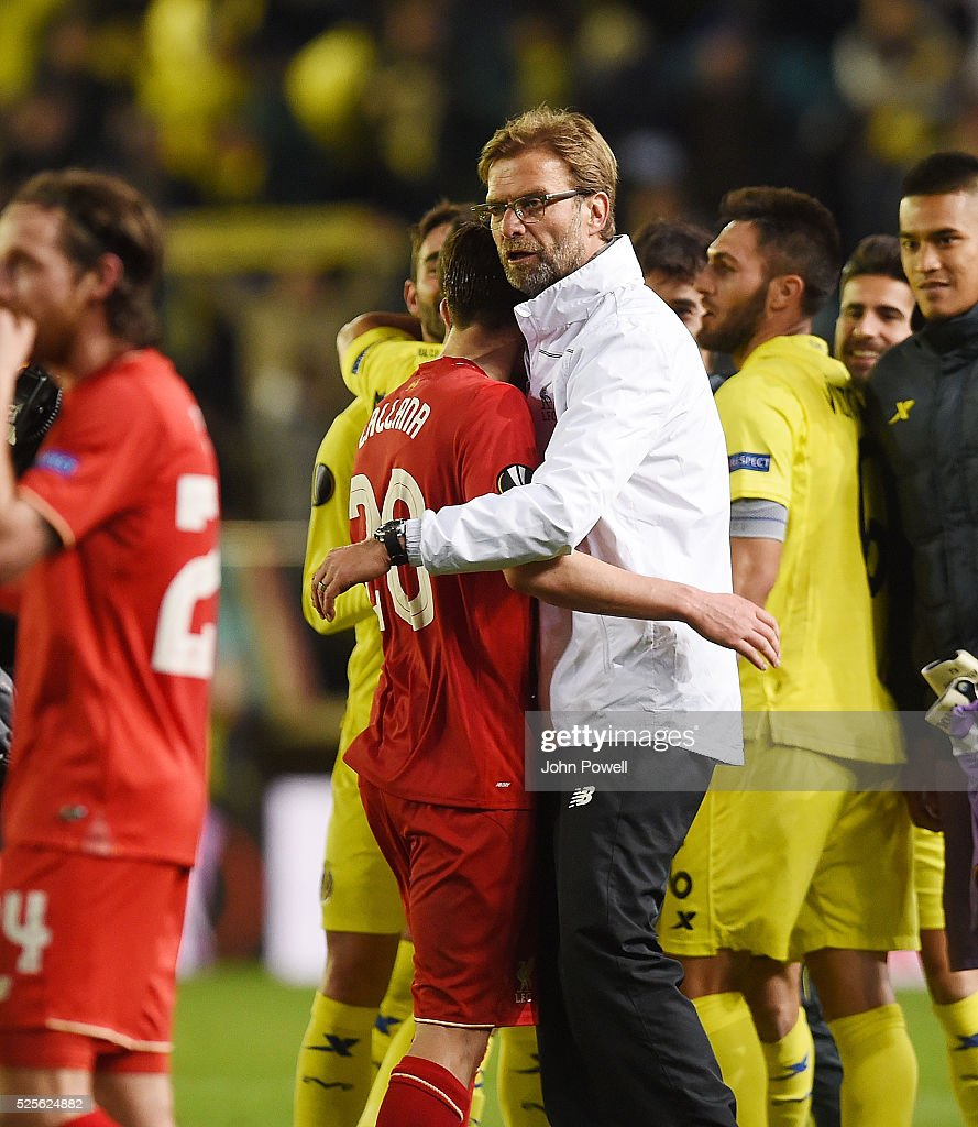 Jurgen Klopp manager of Liverpool embraces Adam Lallana of Liverpool at the end of the UEFA Europa League Semi Final: First Leg match between Villarreal CF and Liverpool on April 28, 2016 in Villarreal, Spain.