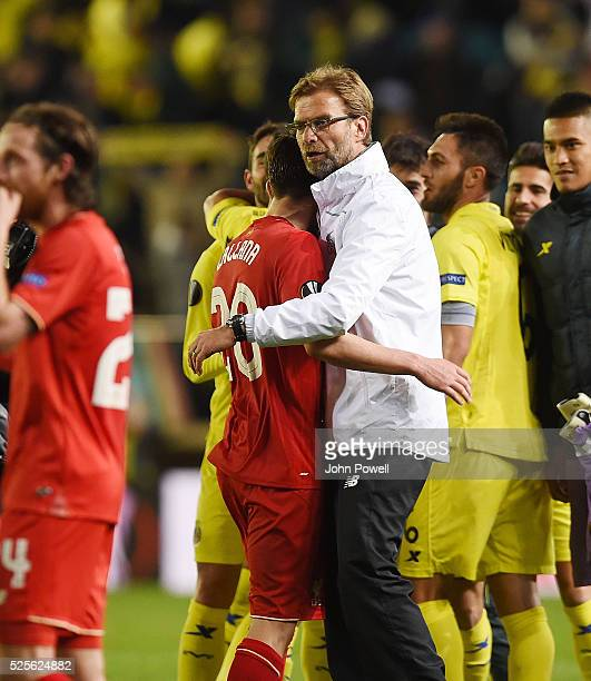 Jurgen Klopp manager of Liverpool embraces Adam Lallana of Liverpool at the end of the UEFA Europa League Semi Final First Leg match between...