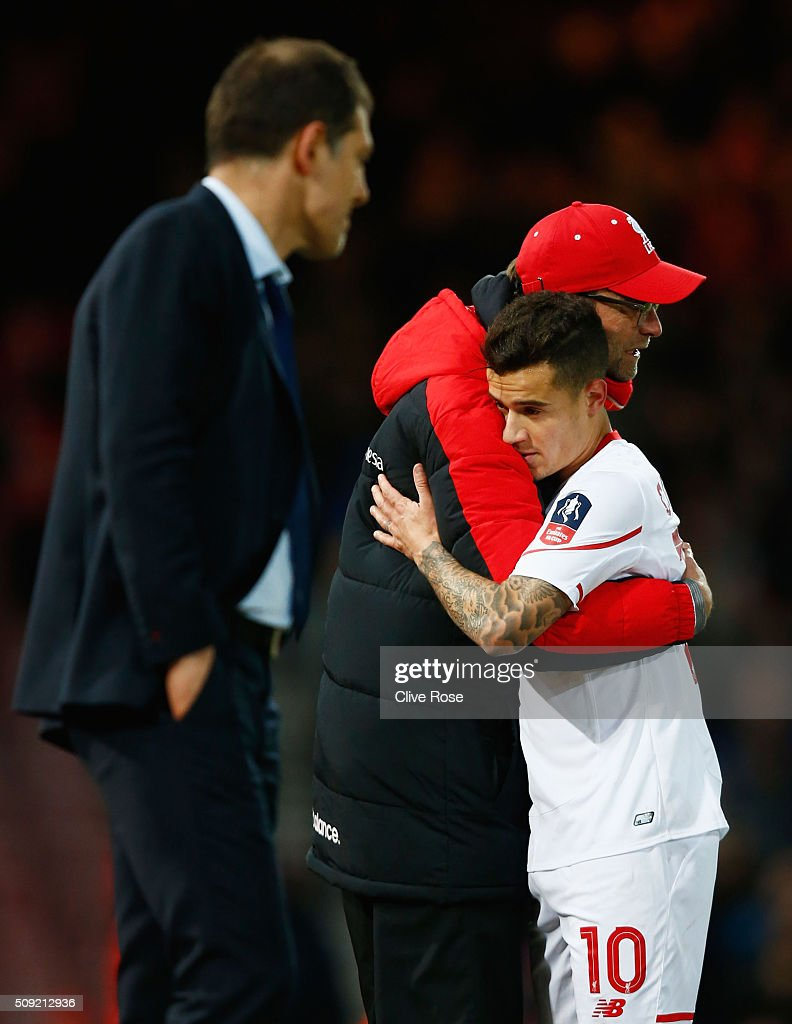 Jurgen Klopp, manager of Liverpool embraces goal scorer <a gi-track='captionPersonalityLinkClicked' href=/galleries/search?phrase=Philippe+Coutinho&family=editorial&specificpeople=6735575 ng-click='$event.stopPropagation()'>Philippe Coutinho</a> of Liverpool as he is substituted during the Emirates FA Cup Fourth Round Replay match between West Ham United and Liverpool at Boleyn Ground on February 9, 2016 in London, England.