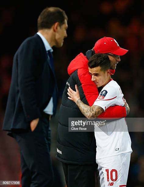Jurgen Klopp manager of Liverpool embraces goal scorer Philippe Coutinho of Liverpool as he is substituted during the Emirates FA Cup Fourth Round...