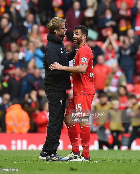 Jurgen Klopp manager of Liverpool embraces Kevin Stewart of Liverpool at the end of the Barclays Premier League match between Liverpool and Stoke...