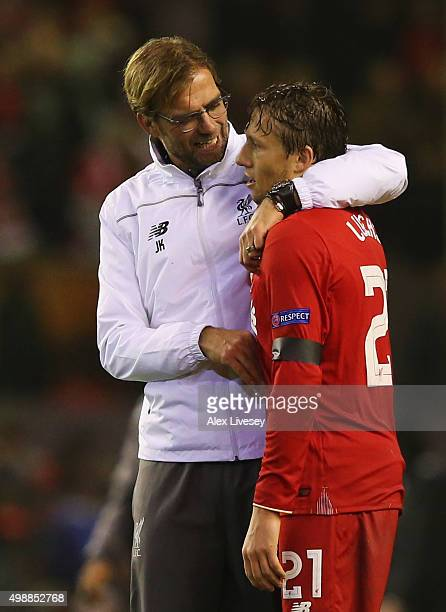 Jurgen Klopp manager of Liverpool embraces Lucasof Liverpool after victory in the UEFA Europa League Group B match between Liverpool FC and FC...
