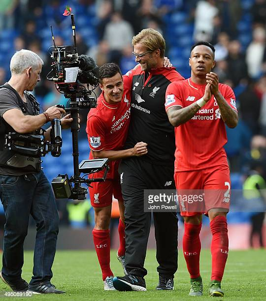 Jurgen Klopp manager of Liverpool embraces Philippe Coutinho at the end of the Barclays Premier League match between Chelsea and Liverpool at...