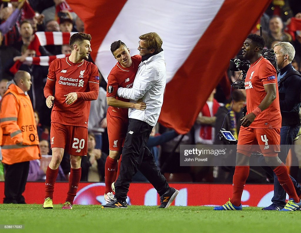 Jurgen Klopp manager of Liverpool embraces Philippe Coutinho at the end of the UEFA Europa League Semi Final: Second Leg match between Liverpool and Villarreal CF at Anfield on May 05, 2016 in Liverpool, England.