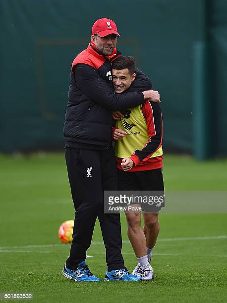Jurgen Klopp manager of Liverpool embraces Philippe Coutinho during a training session at Melwood Training Ground on December 18 2015 in Liverpool...