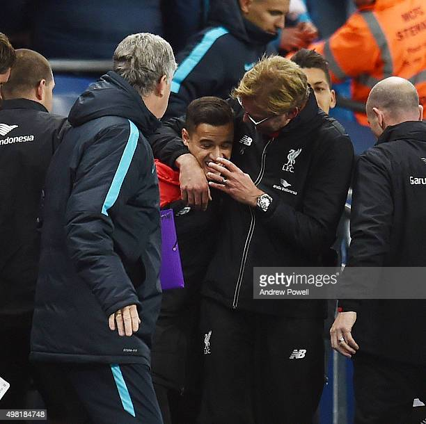 Jurgen Klopp manager of Liverpool embraces Philippe Coutinho of Liverpool at the end of the Barclays Premier League match between Manchester City and...
