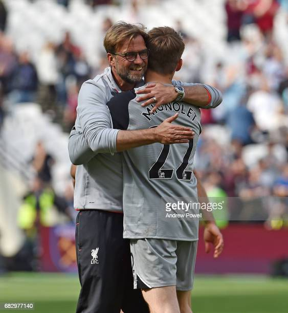 Jurgen Klopp manager of Liverpool embraces Simon Mignolet at the end of the Premier League match between West Ham United and Liverpool at London...