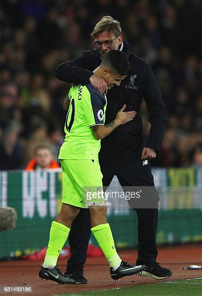 Jurgen Klopp manager of Liverpool embraces substitute Philippe Coutinho of Liverpool during the EFL Cup semifinal first leg match between Southampton...