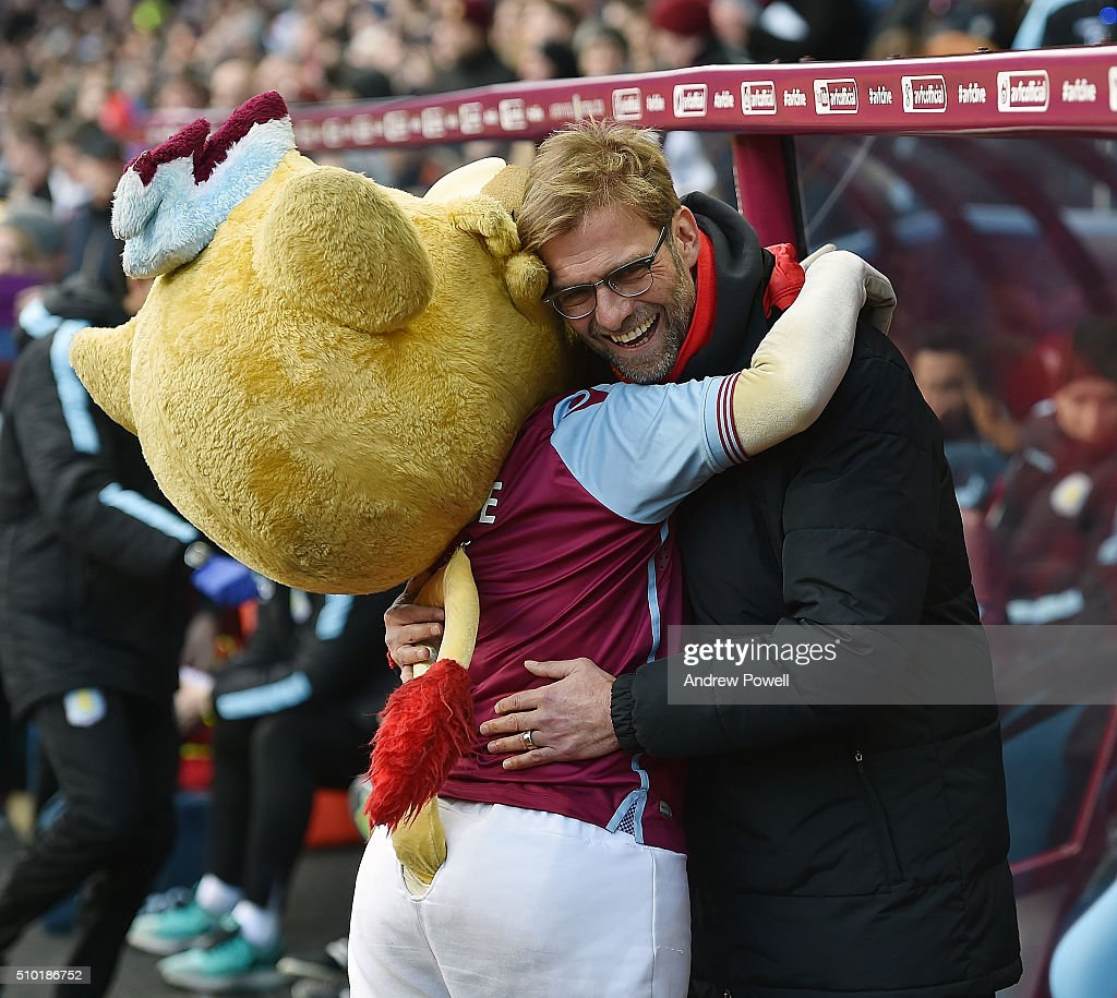 Jurgen Klopp manager of Liverpool embraces the Aston Villa mascot before the Barclays Premier League match between Aston Villa and Liverpool at Villa Park on February 14, 2016 in Birmingham, England.
