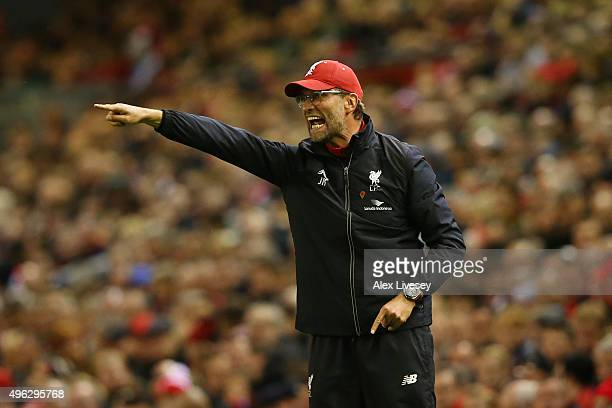 Jurgen Klopp Manager of Liverpool gestures to his players during the Barclays Premier League match between Liverpool and Crystal Palace at Anfield on...