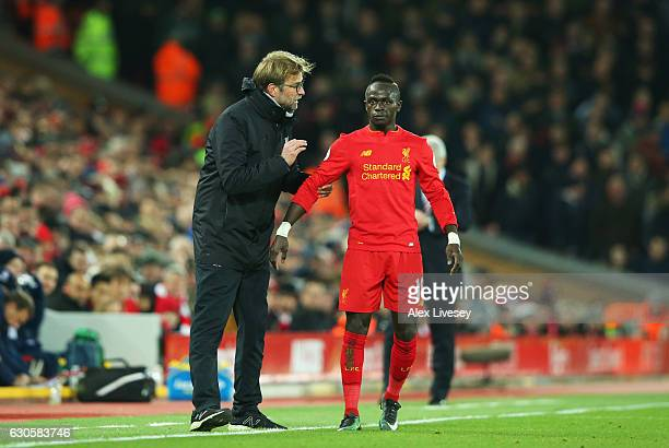 Jurgen Klopp manager of Liverpool gives instructions to Sadio Mane of Liverpool during the Premier League match between Liverpool and Stoke City at...
