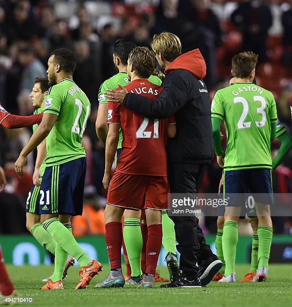 Jurgen Klopp manager of Liverpool gives Lucas Leiva of Liverpool a hug at the end of the Barclays Premier League match between Liverpool and...