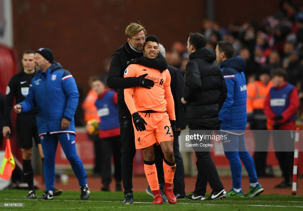 Jurgen Klopp, Manager of Liverpool holds back Alex Oxlade-Chamberlain of Liverpool after an altercation during the Premier League match between Stoke City and Liverpool at Bet365 Stadium on November 29, 2017 in Stoke on Trent, England.
