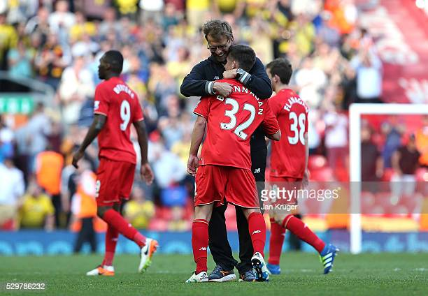 Jurgen Klopp manager of Liverpool hugs Cameron Brannagan following the Barclays Premier League match between Liverpool and Watford at Anfield on May...