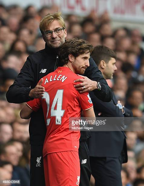 Jurgen Klopp manager of Liverpool hugs Joe Allen as he brings in during the Barclays Premier League match between Tottenham Hotspur and Liverpool at...