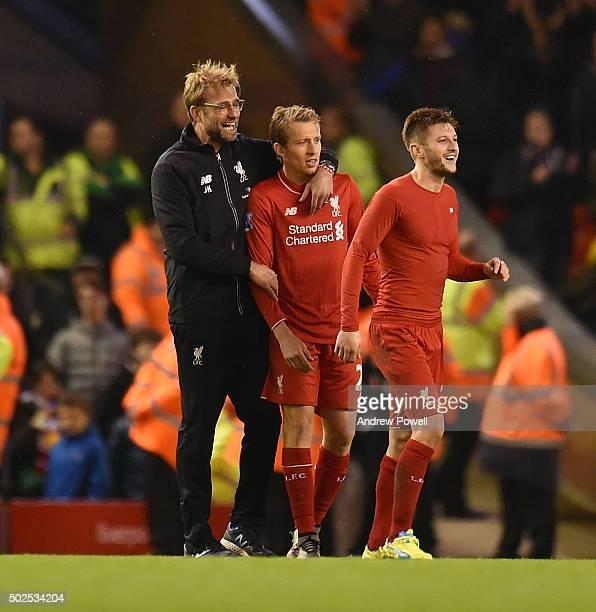 Jurgen Klopp manager of Liverpool hugs Lucas Leiva of Liverpool at the end of the Barclays Premier League match between Liverpool and Leicester City...