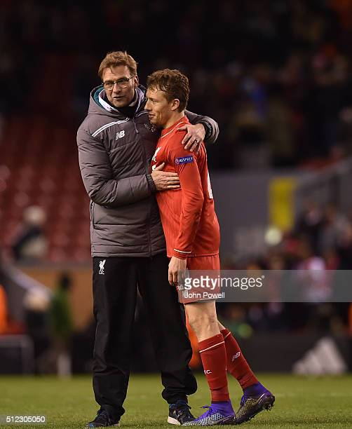 Jurgen Klopp manager of Liverpool hugs Lucas Leiva of Liverpool at the end of the UEFA Europa League Round of 32 second leg match between Liverpool...