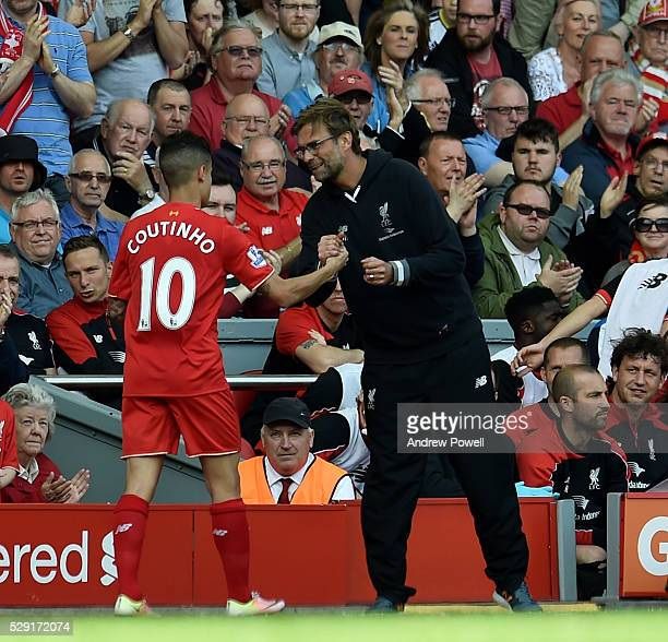 Jurgen Klopp manager of Liverpool hugs Philippe Coutinho of Liverpool as he is substituted during the Barclays Premier League match between Liverpool...