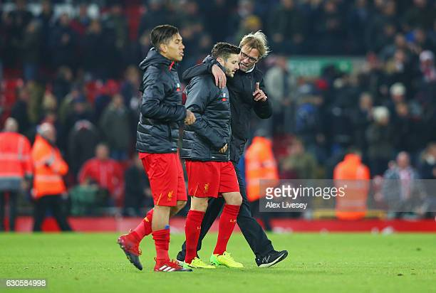 Jurgen Klopp manager of Liverpool in discussion with Adam Lallana and Roberto Firmino of Liverpool after the Premier League match between Liverpool...