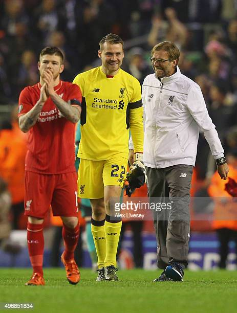 Jurgen Klopp manager of Liverpool jokes with Simon Mignolet of Liverpool after victory in the UEFA Europa League Group B match between Liverpool FC...