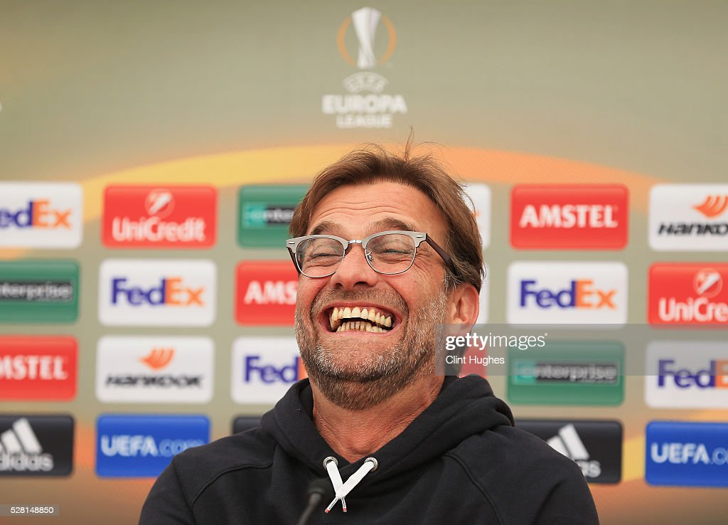 Jurgen Klopp, manager of Liverpool laughs during a press conference ahead of the UEFA Europa League Semi-Final Second Leg match against Villarreal at Melwood Training Ground on May 4, 2016 in Liverpool, England.